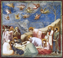 """Giotto's masterpiece is a series of frescoes that decorate the wall of a small chapel in Padua, Italy. Working between 1305 and 1306, Giotto illustrated the lives of Christ and the Virgin Mary on the Arena Chapel's walls. He used the fresco technique to fill the walls of the chapel with three powerful bands of paint. """"The Lamentation"""" is one of the paintings in the series. The scene appears to be played out be a group of real people. The figures are in active, natural poses: leaning, holding, sitting, and bending. They are monumental and solid. The large folds in their robes suggest weight and mass. His use of shading creates a sense of roundness and natural light that comes from above outside the limits of the picture. Finally, a hint of natural landscape (not a gold background that was typical of the Medieval style) enhances the reality of the event."""