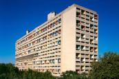 "Brutalism: Le Corbusier's first Unité d'Habitation is arguably the most influential Brutalist building of all time. With its human proportions, chunky pilotis and interior ""streets"", it redefined high-density housing by reimagining a city inside an 18-storey slab block."
